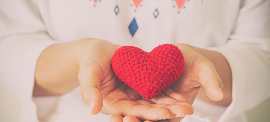 Women wear knit shirt hand holding red heart. Concept of love, hope, happy valentine, healthcare,organ donation,insurance, medical, World heart day, National Organ Donor day,World mental health day.